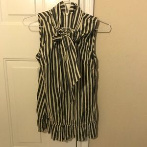 The limited striped blouse with a front bow